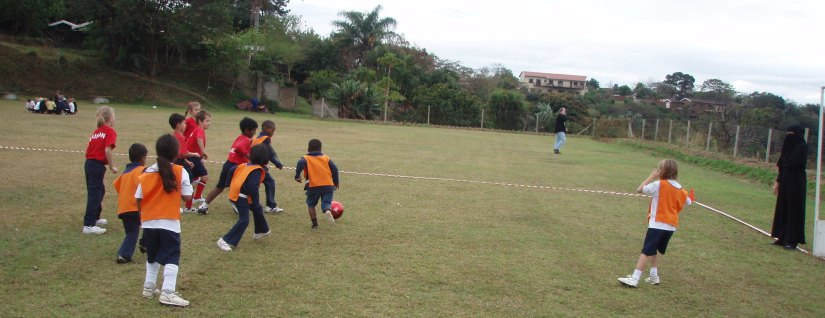 Tom on the ball, with Soccer Ma coaching